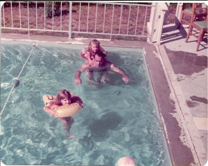 My sister, Uncle Jack and I in my grandparents pool.