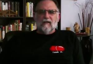 Paul Elam wearing Red pill shirt